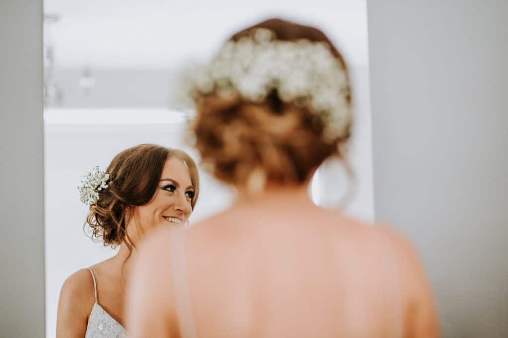 A bride laughs on her wedding morning