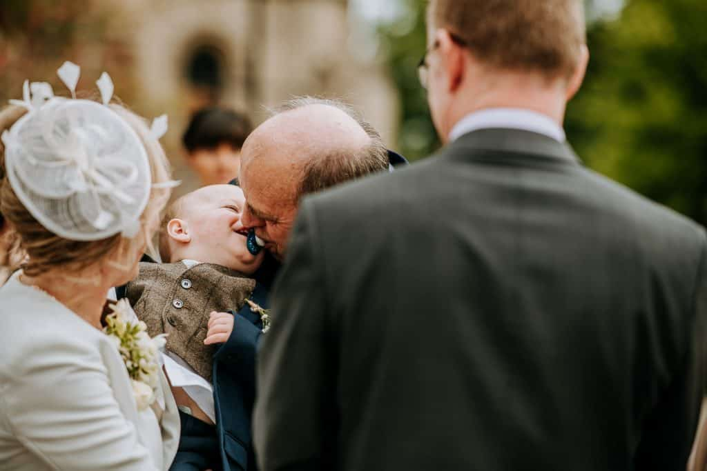 An uncle plays with his nephew just before a church wedding in Yorkshire