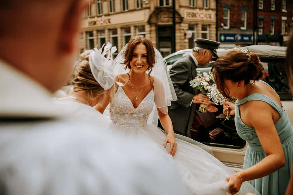 A bride arrives at her church wedding venue