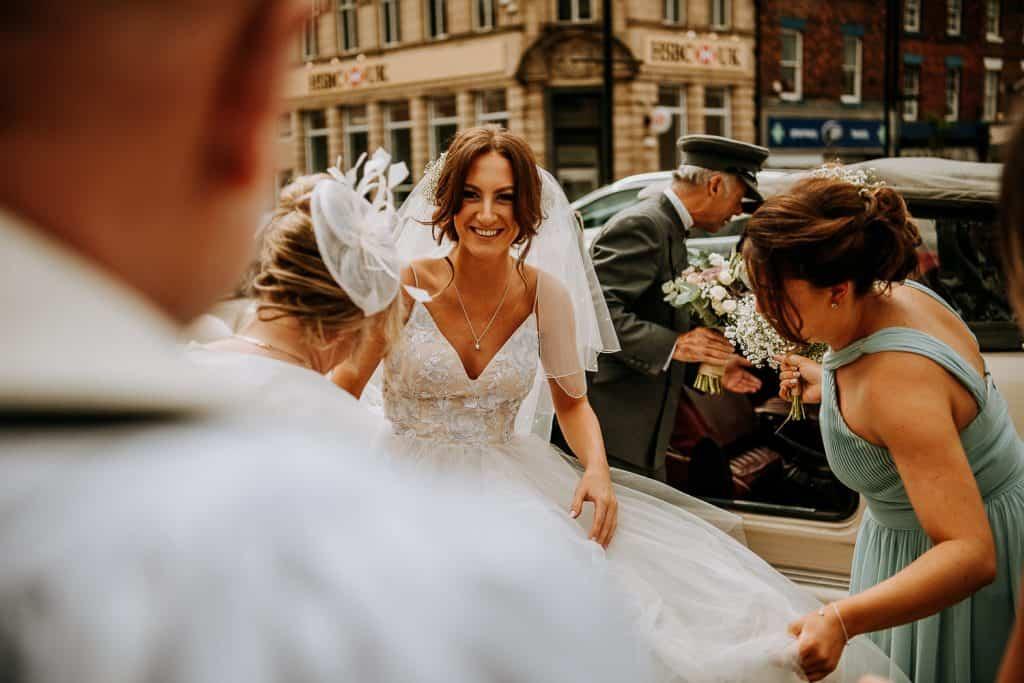A bride arrives at her church wedding venue