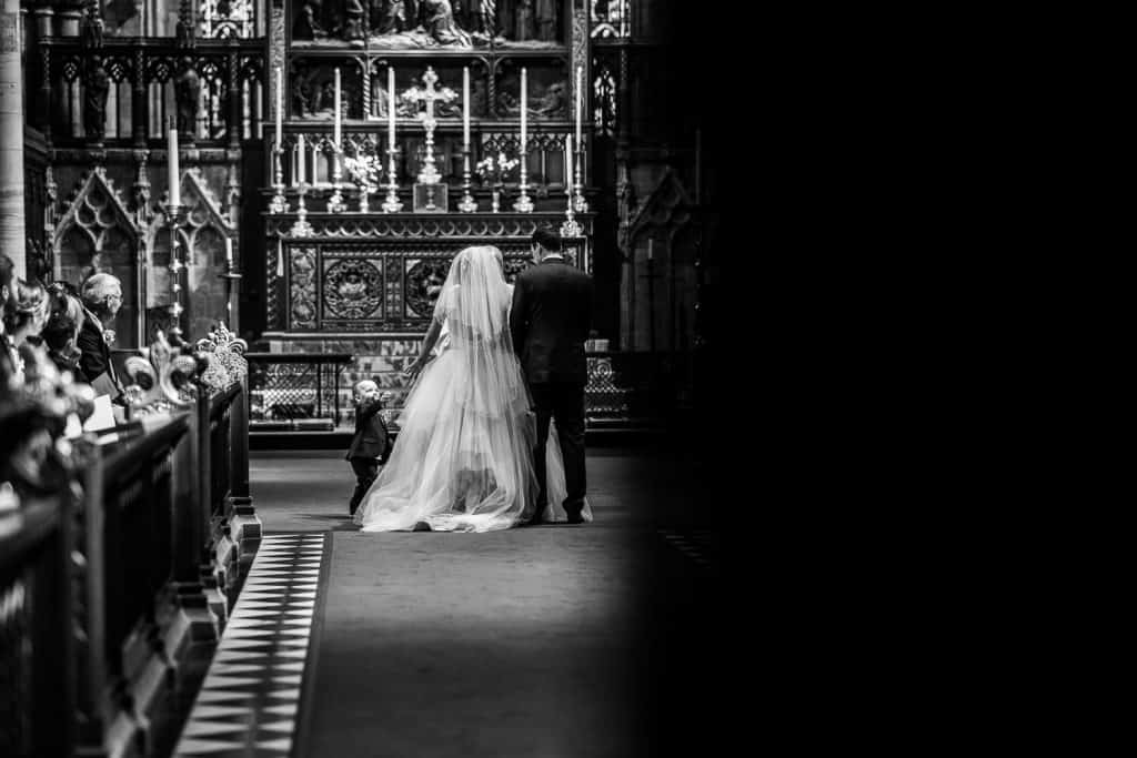 A black and white image of a couple getting married at Selby Abbey