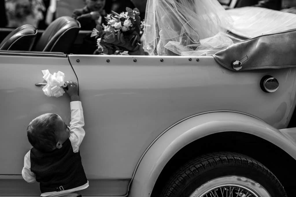 A young boy opens the wedding car door at Berts Barrow in Yorkshire