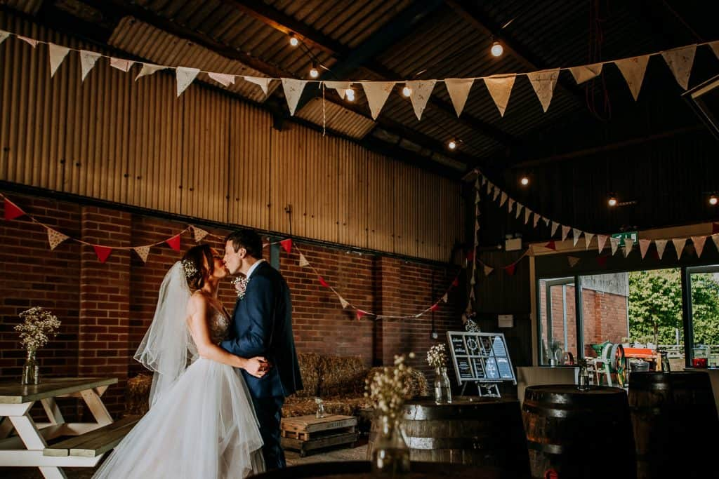 A couple share a kiss at Berts Barrow wedding venue in Yorkshire