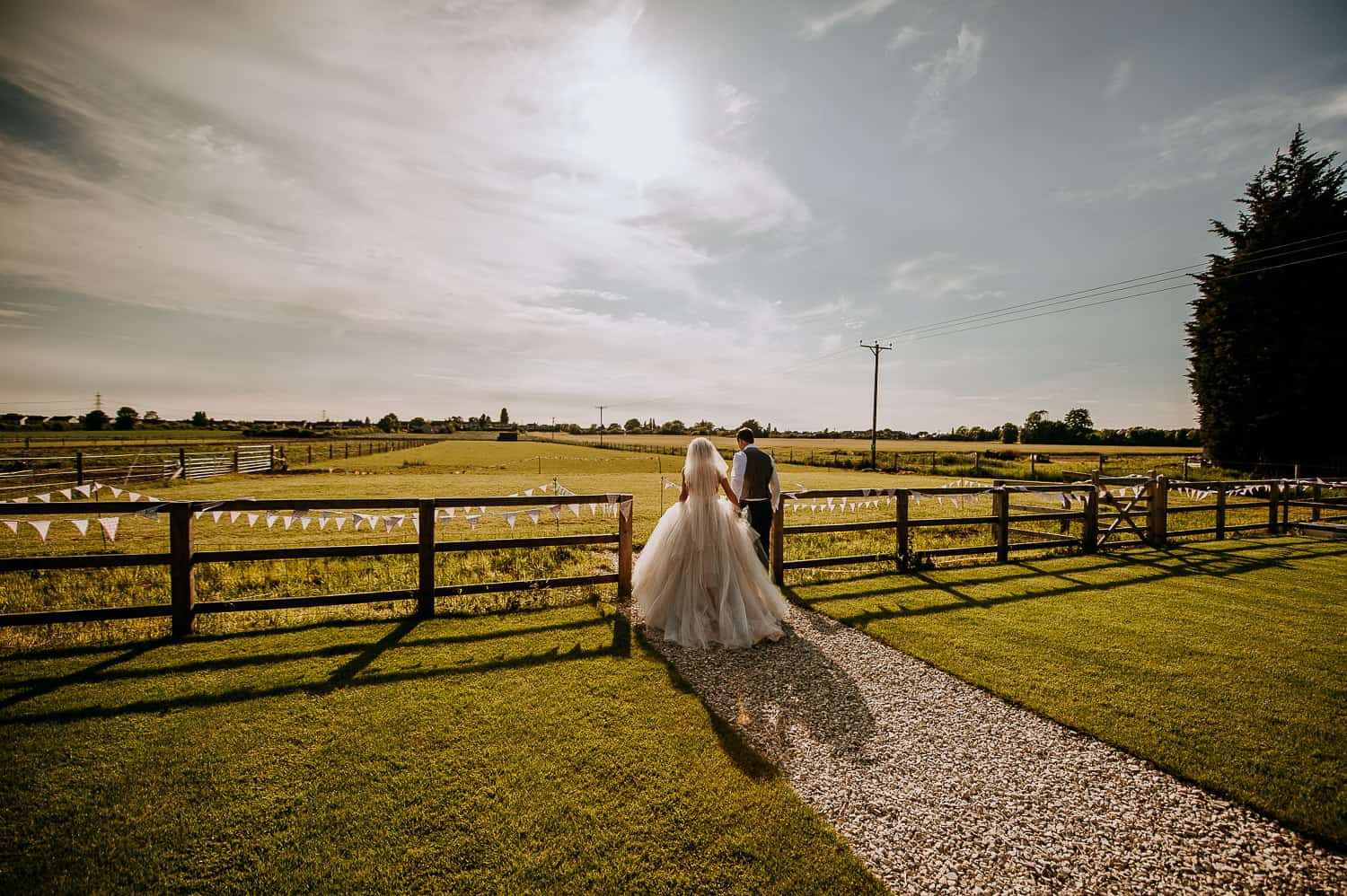 A bride and groom walk together at Berts Barrow wedding venue
