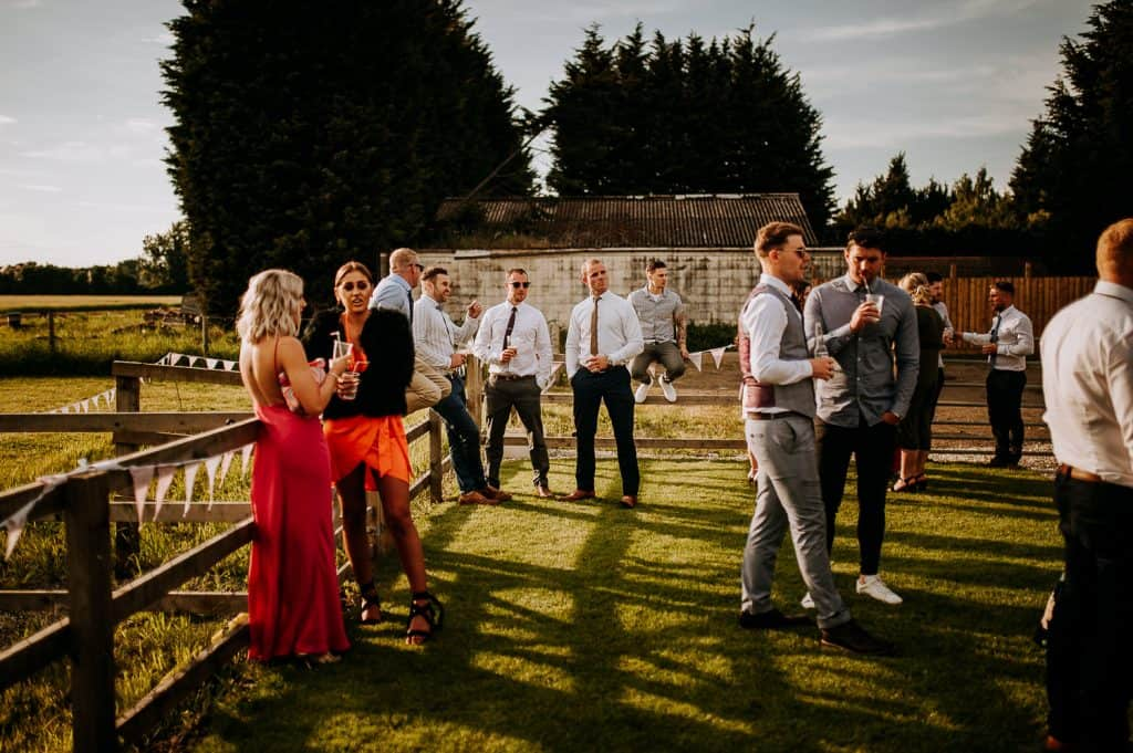 Wedding guests enjoy the summer sun at Bert's Barrow
