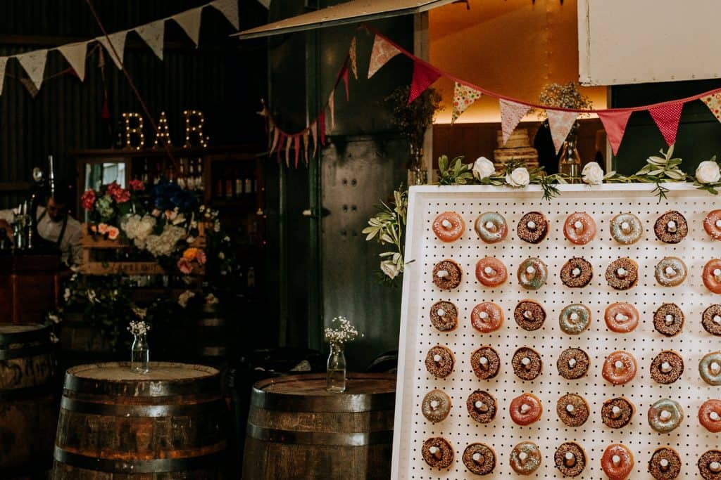 A wall of doughnuts for wedding guests to enjoy at Berts Barrow