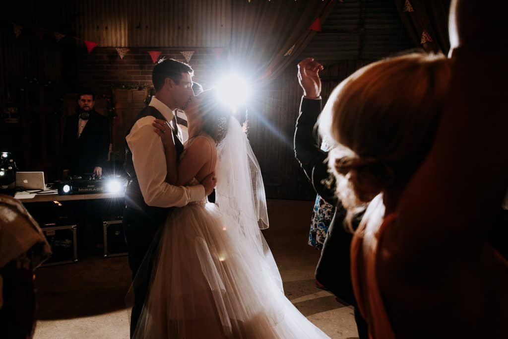 A bride and groom share a kiss on the dance floor at Berts Barrow