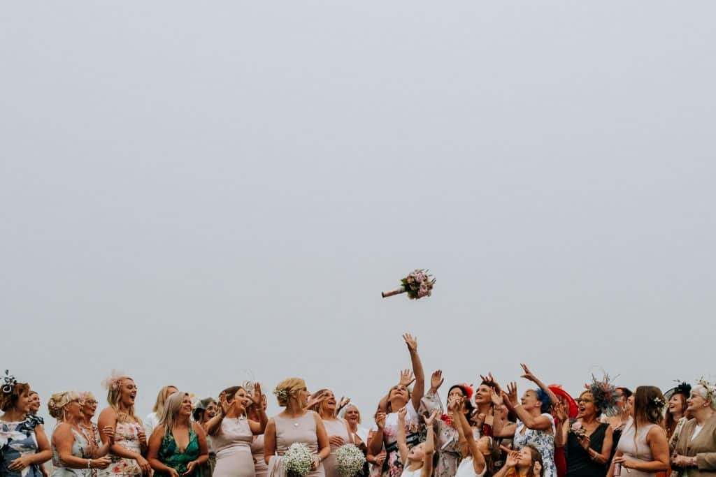 Bouquet toss by Yorkshire Wedding Photographer M and G Wedding Photography