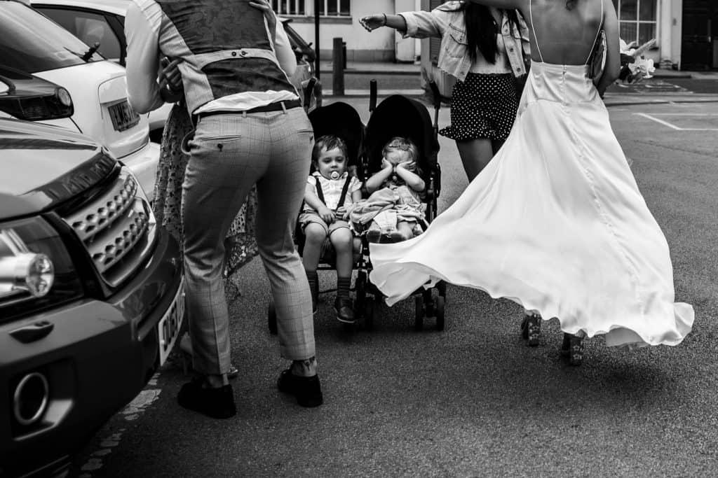 Tired children in a pram on a wedding day