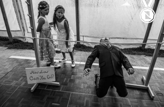 Yorkshire wedding photographer award winning image of children playing limbo at a wedding