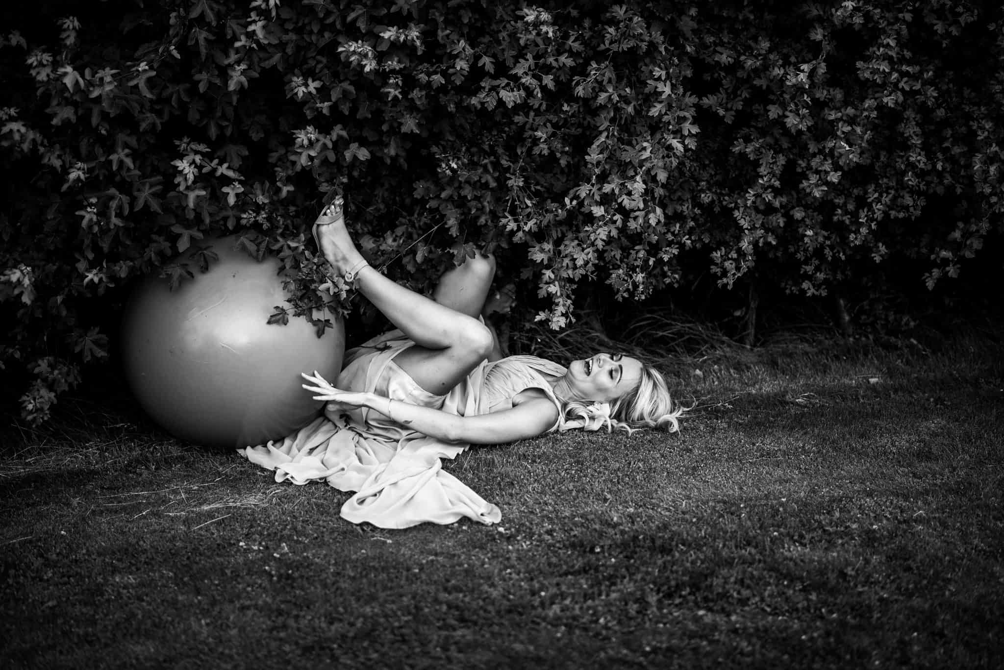 A wedding guest falls off a space hopper and laughs uncontrollably captured by Yorkshire wedding photographer M and G Wedding Photography