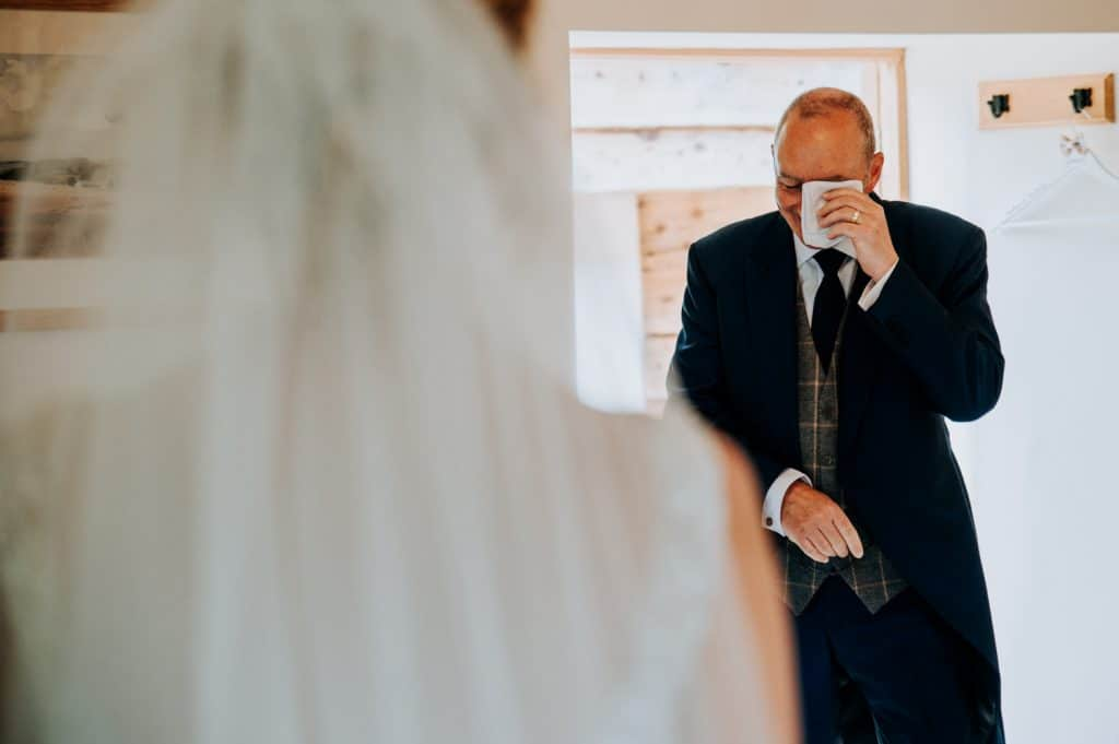 An emotional dad sees his daughter in her wedding dress