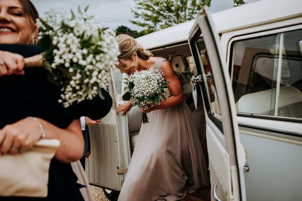 Bridesmaids arrive at the beautiful Cotswolds wedding venue Cripps Stone Barn
