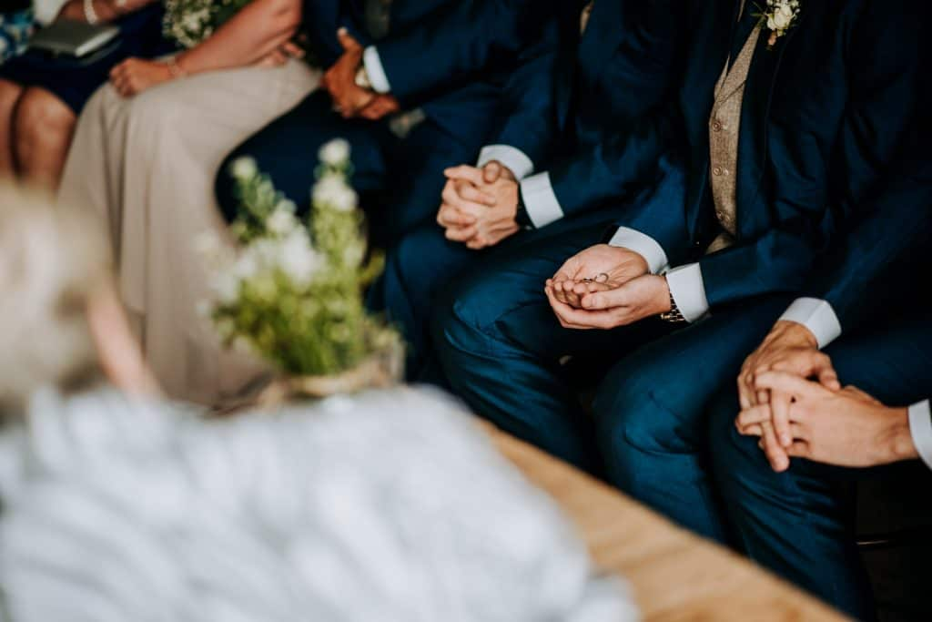 The best man holds the wedding rings at a wedding at the Cotswolds wedding venue Stone Barn