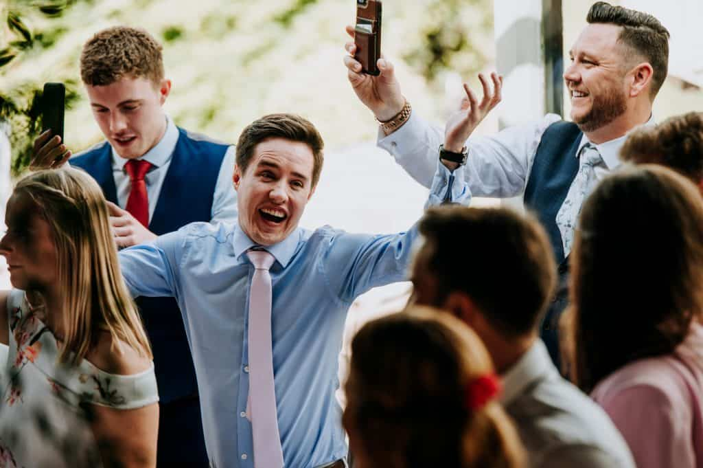 A wedding guest reacts in amusing fashion to a wedding speech