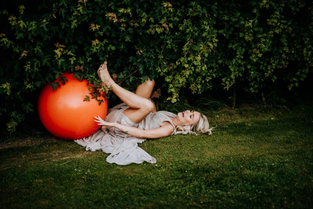 A bridesmaid falls off a space hopper and laughs hysterically