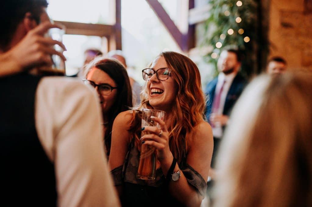 Wedding guests enjoy the wedding reception at Stone Barn