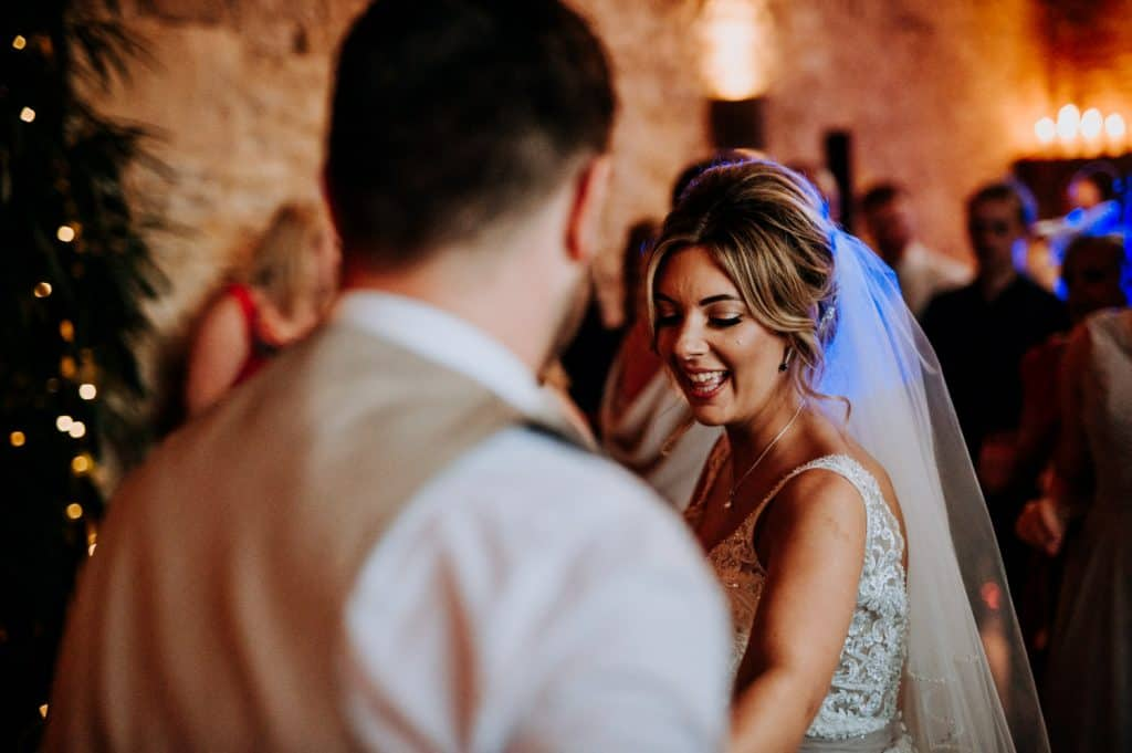 A bride and groom enjoy their first dance at Stone Barn in the Cotswolds