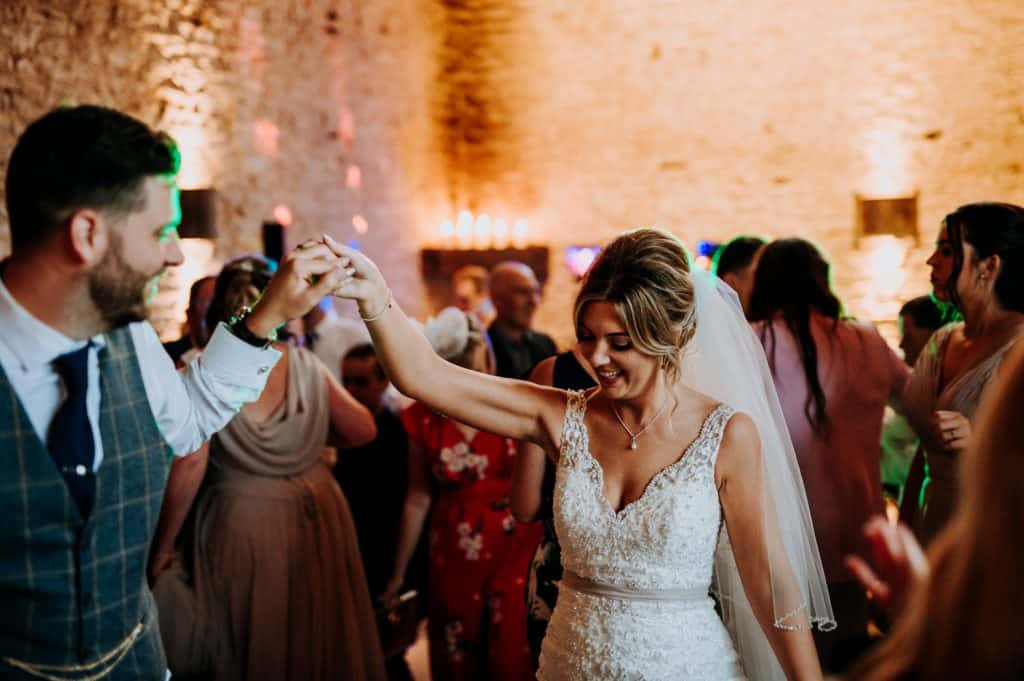 A beautiful first dance with the bride and groom at the Cotswolds wedding venue Stone Barn