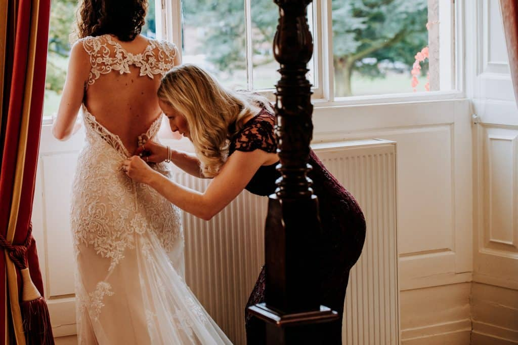Bride getting her bridal gown on
