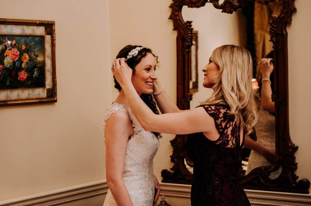 Bride getting her tiara put on by a bridesmaid
