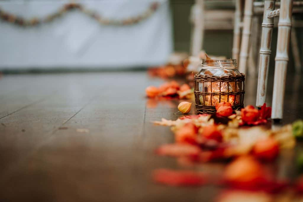 Beautiful autumnal floral decorations at a wedding ceremony by Offley Place wedding photographer M and G Wedding Photography