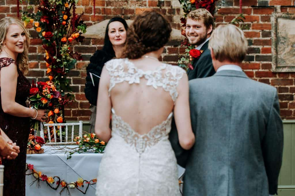 A groom sees his bride on their wedding day for the first during the wedding ceremony