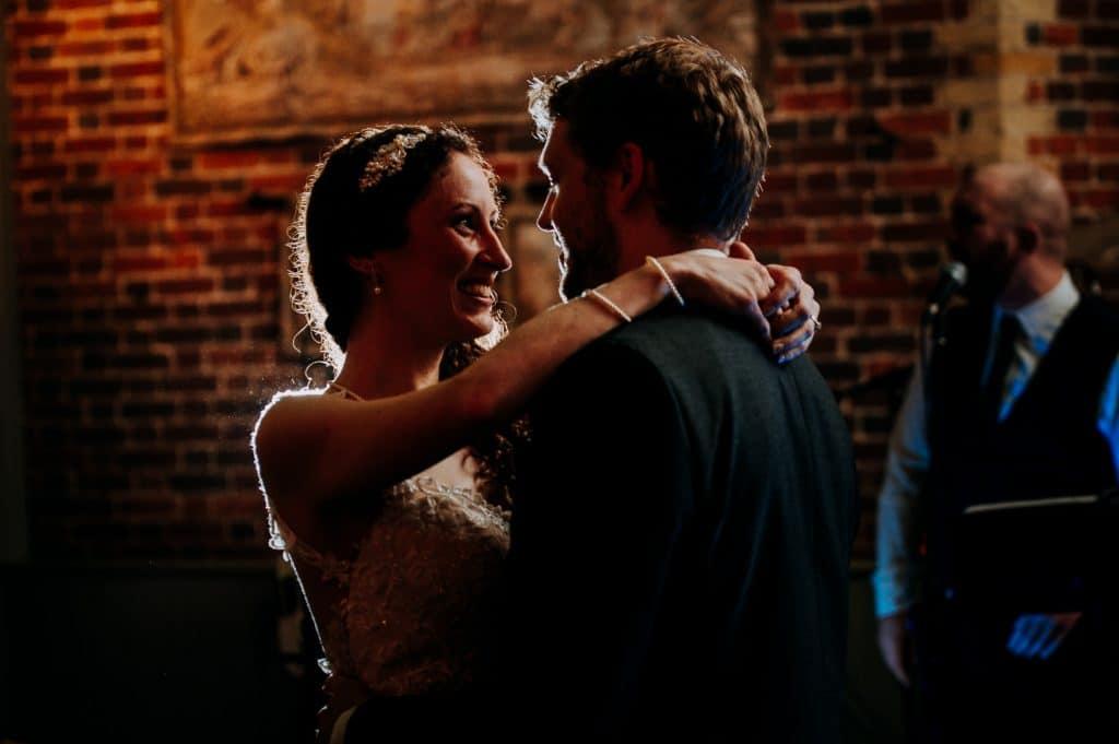 A bride and groom enjoy their first dance on their wedding night