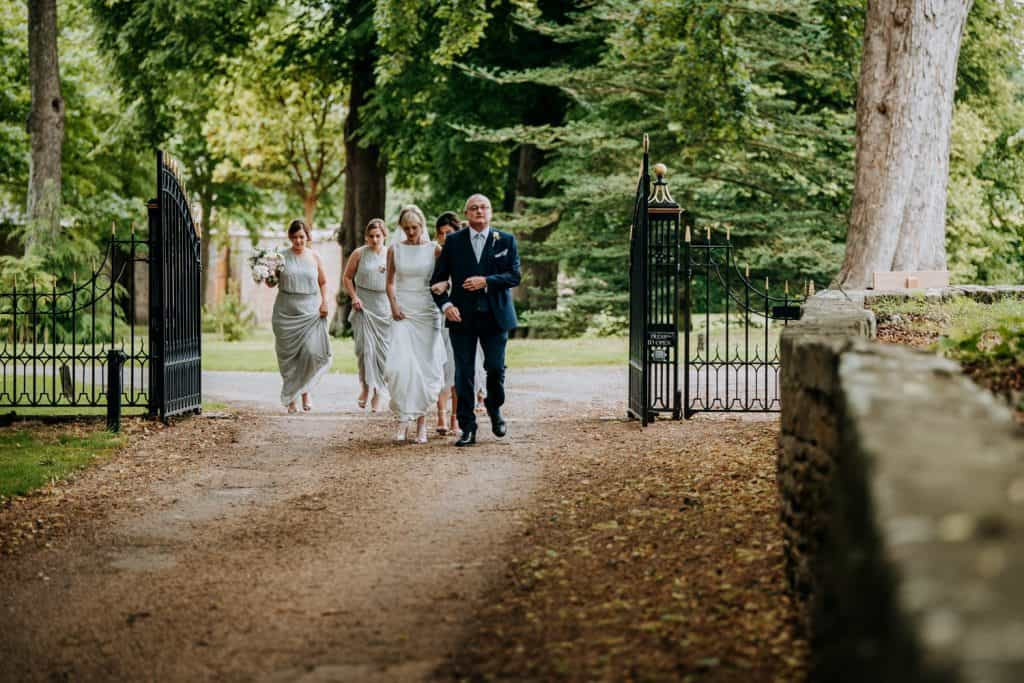 The bride and her bridal party arrive at the Yorkshire wedding venue Orangery Settrington