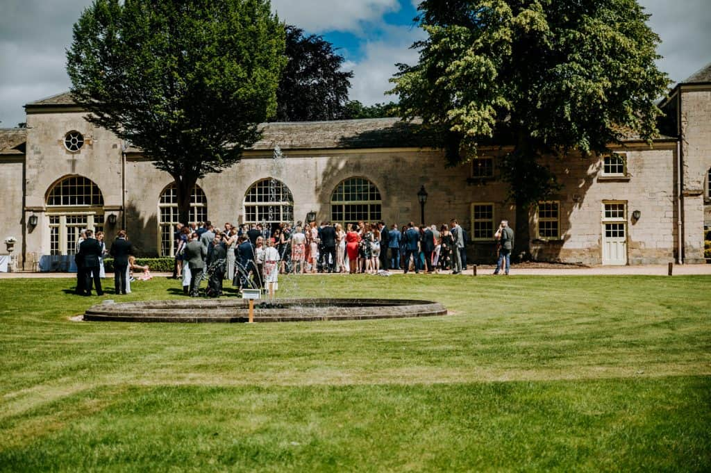 A natural landscape image showing all weddings guests by Orangery Settrington wedding photographer M and G Wedding Photography