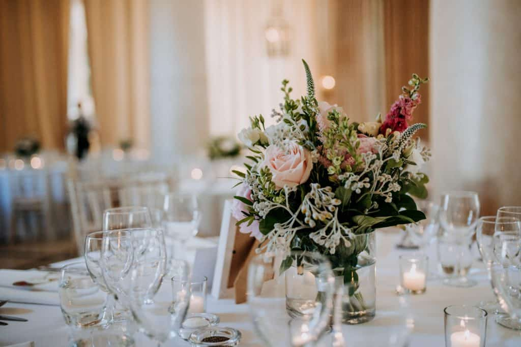 Beautiful flowers adorn a table at a wedding venue