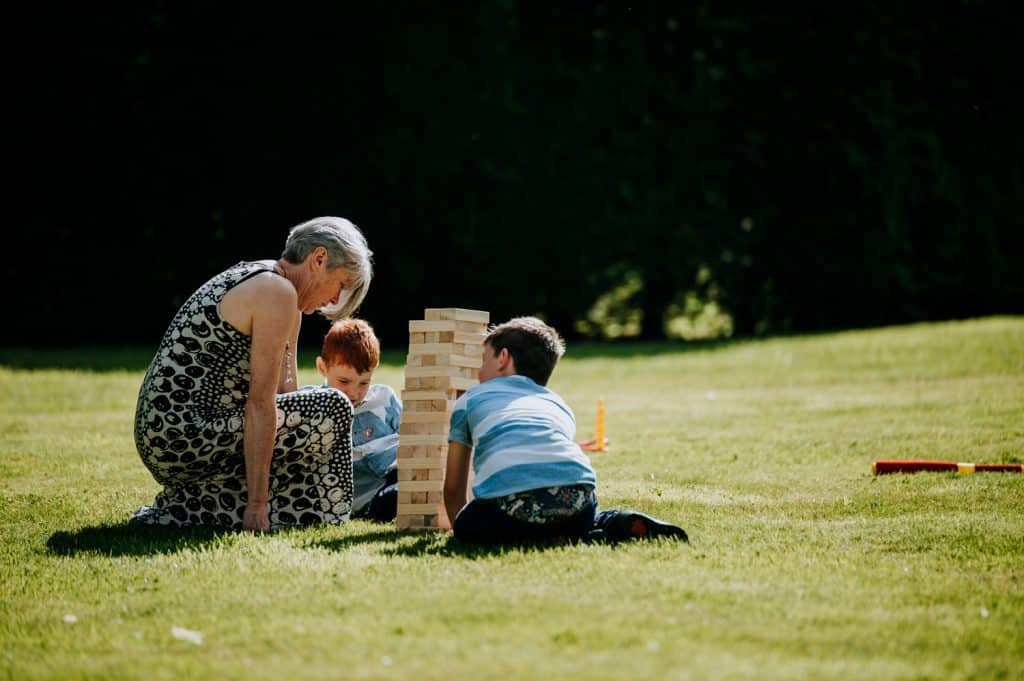 Wedding guests play the game jenga on a lawn at a wedding venue