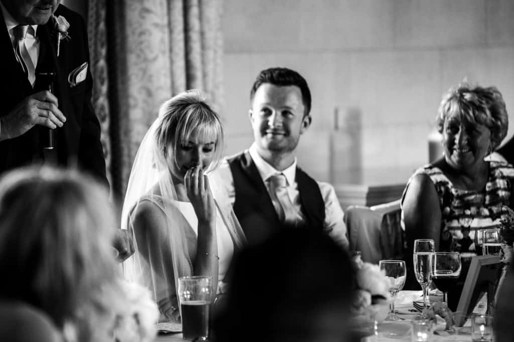 A bride begins to cry during the wedding speeches captured by Orangery Settrington wedding photographer M and G Wedding Photography