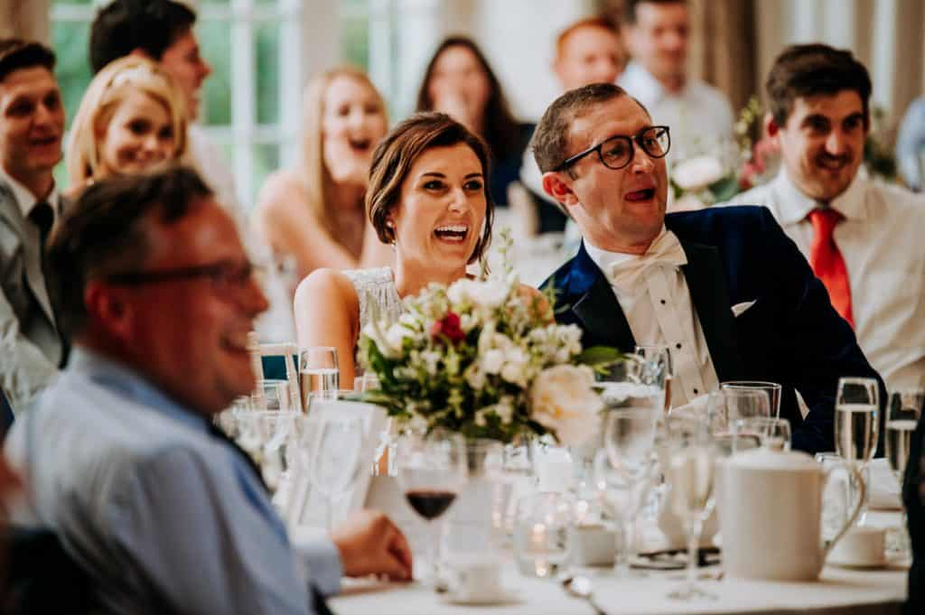 An image showing the reaction of wedding guests to the wedding speeches