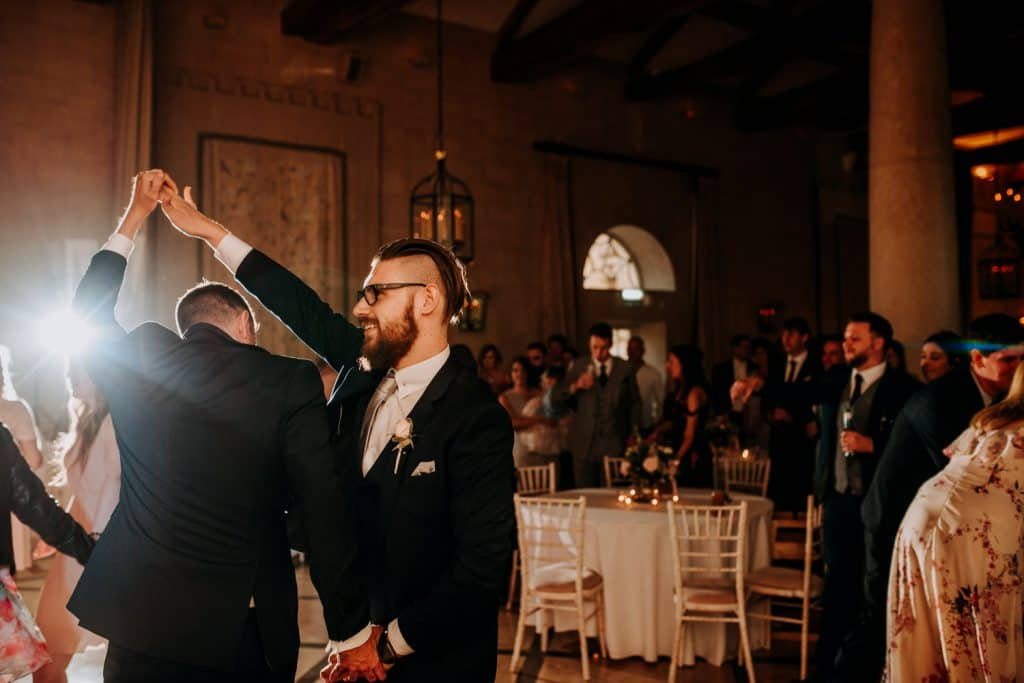 Two men dance together at a Yorkshire wedding