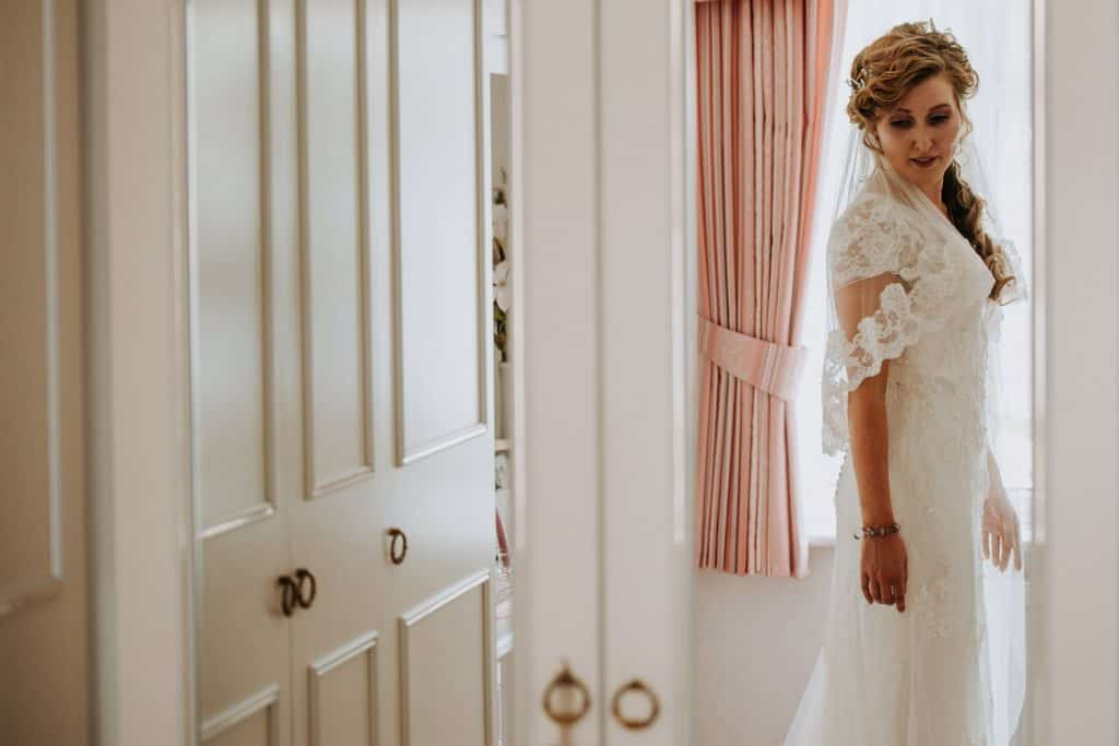 A bride stands ready on her wedding day