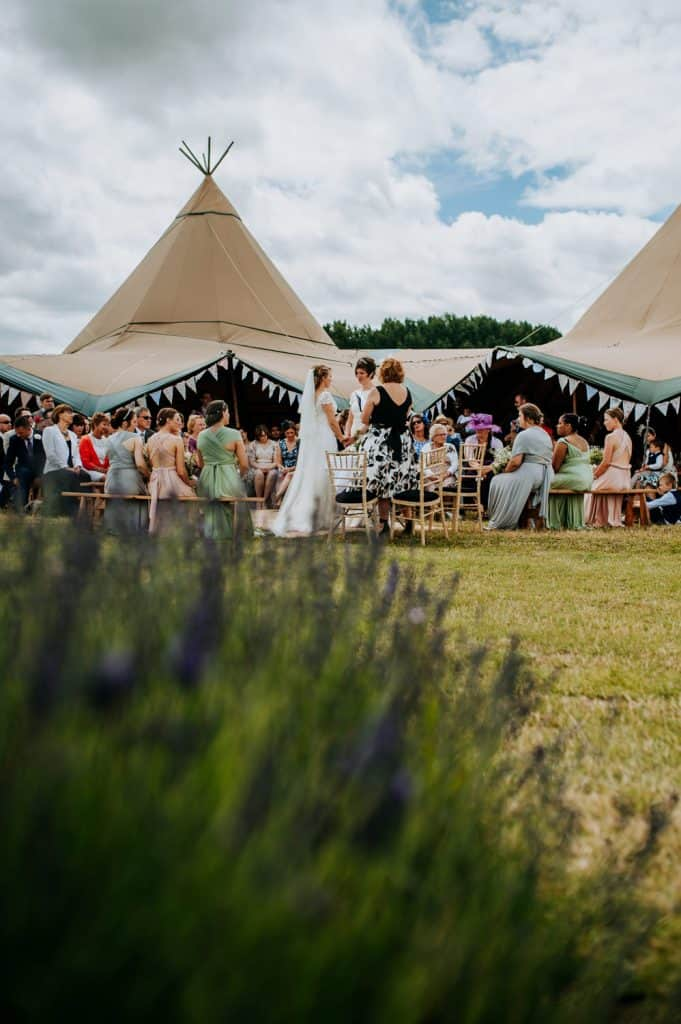 An outdoor wedding ceremony in Hertfordshire at Hitchin Lavender