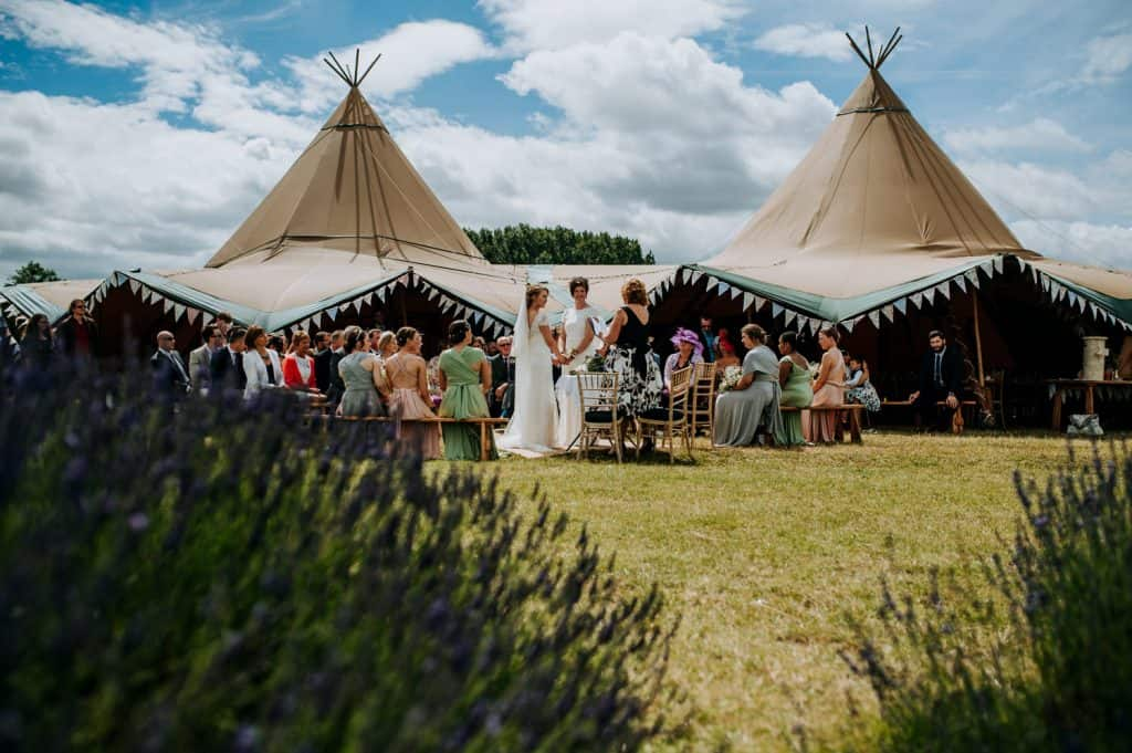 A wide shot from distance of a wedding at Hitchin Lavender in Hertfordshire