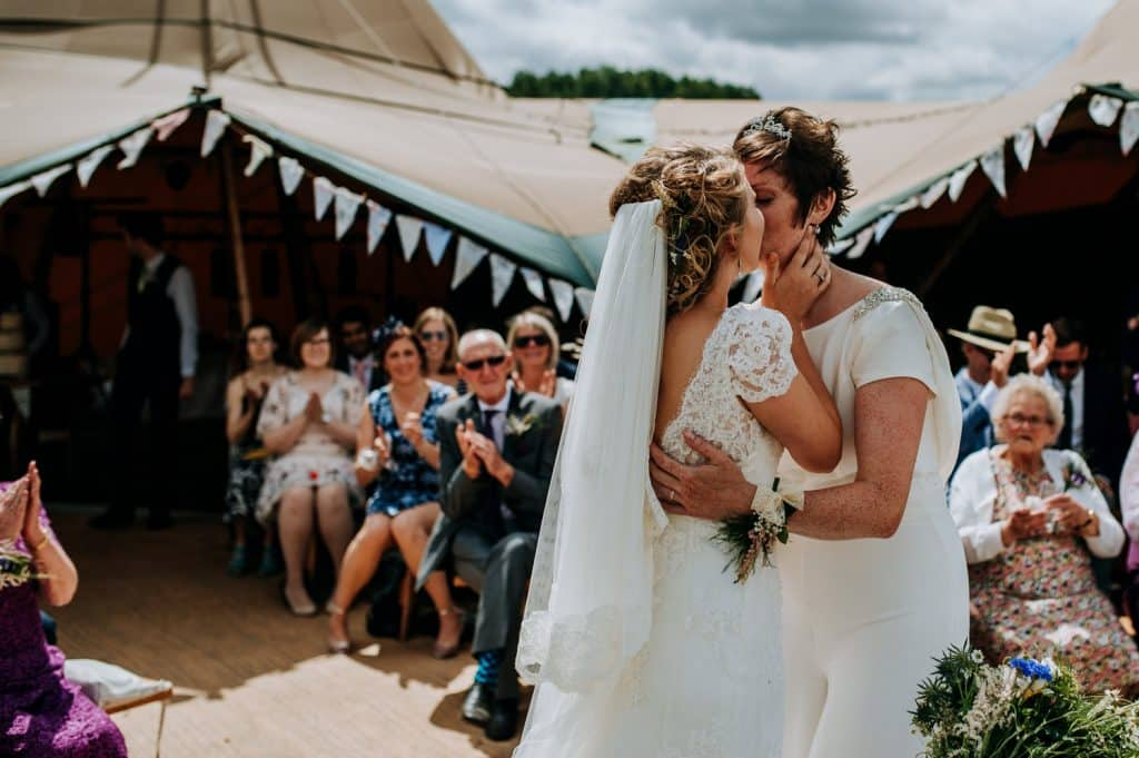 Two brides share their first kiss at their Hitchin Lavender wedding