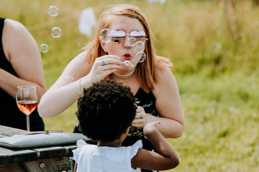 Wedding guests enjoy playing with bubbles