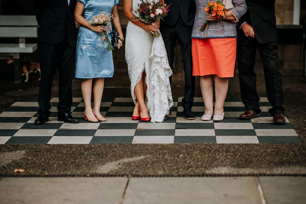 wedding guests posing on a chess board in Leeds