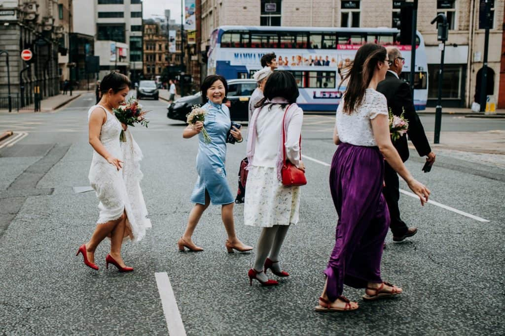 bridal party crossing a busy street in Leeds
