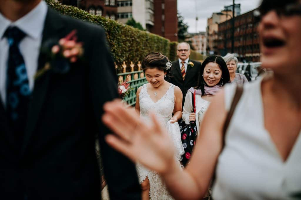 shot through guests shoulders of the bride and her friend