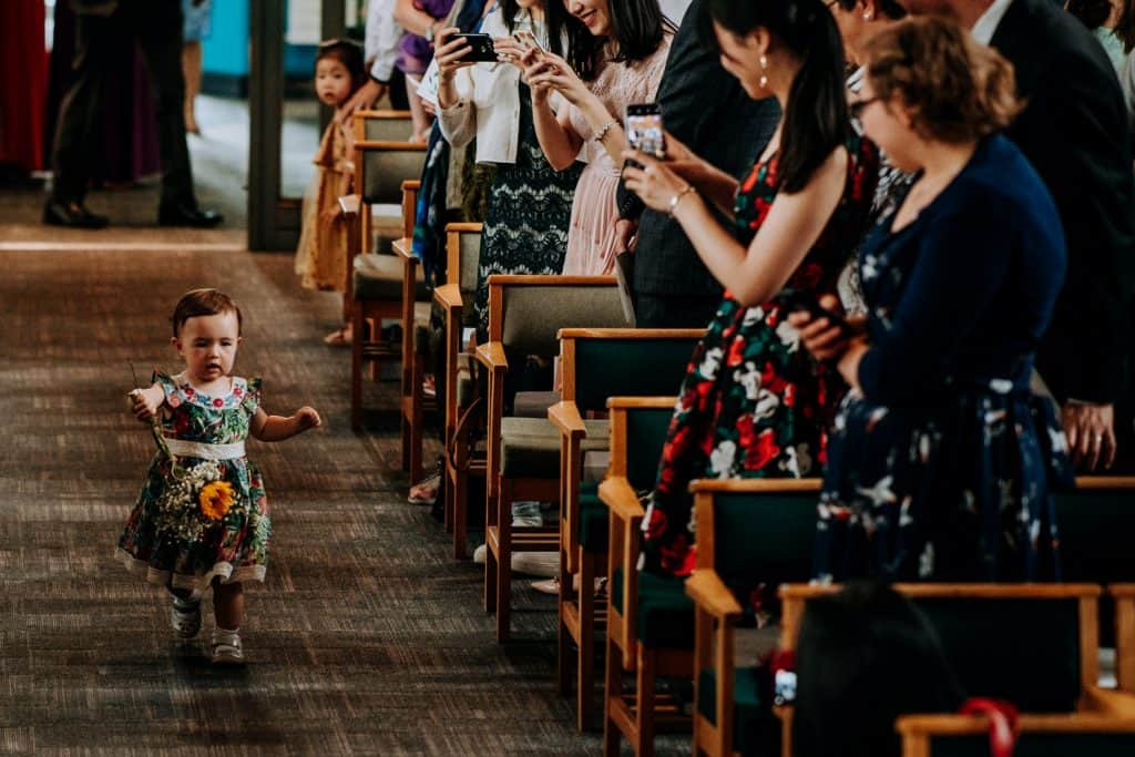 flower girl runs down the aisle