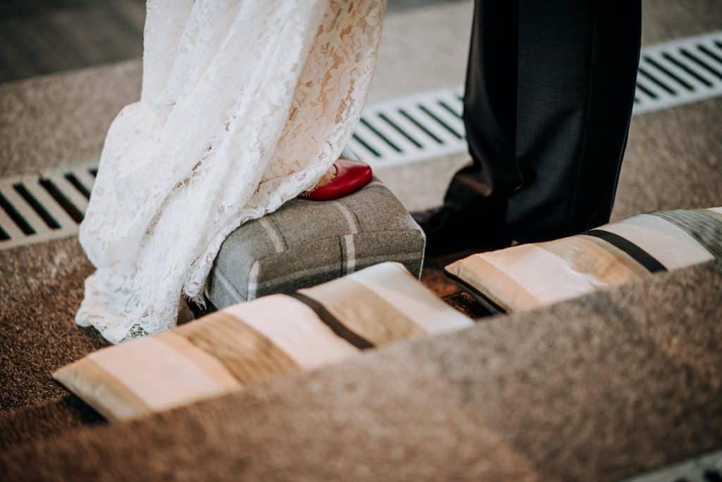 close up shot of the brides red shoes on the stool