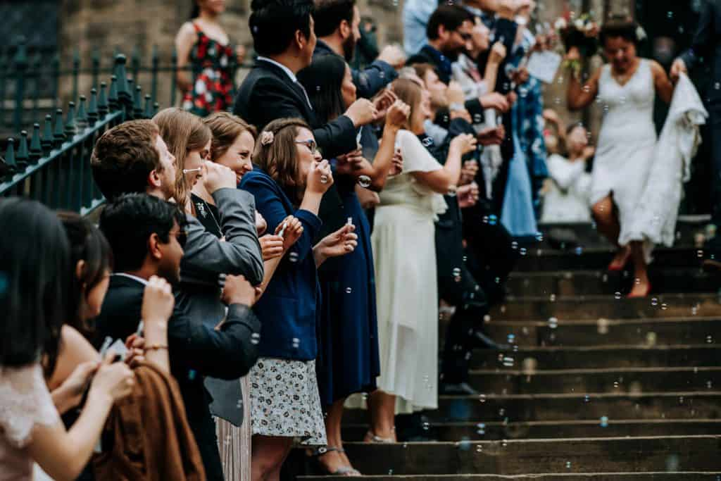 image of guests blowing bubbles