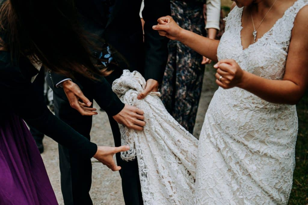 helping hands rush to fix the wedding dress