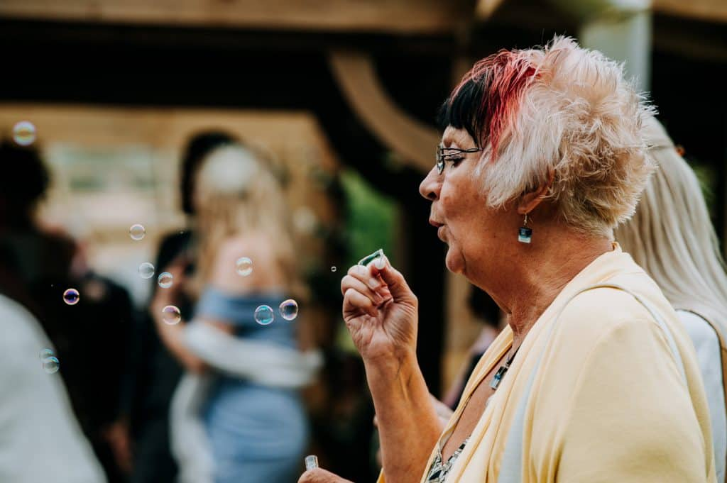 A wedding guest blows bubbles at the Grand Lodge in East Yorkshire