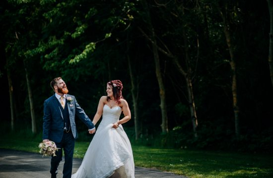 A laughing bride and groom at Oaklands in Yorkshire