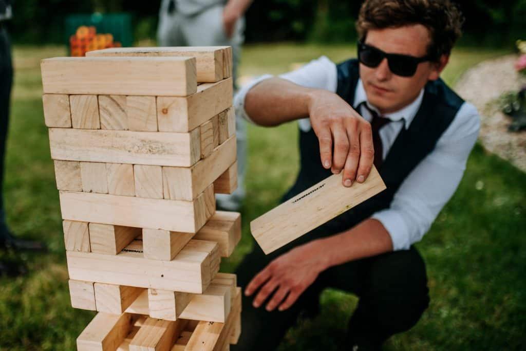 A wedding guest plays giant jingo
